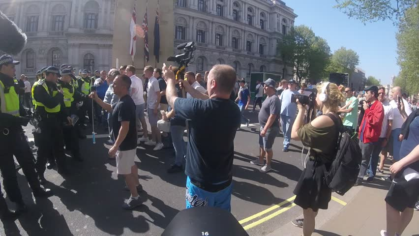 A fight breaks out between protesters and people attending the event during the Day For Freedom event held in Whitehall, London, England. 06/05/18