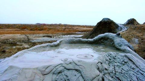 Boiling muddy bubbles in crater of mud volcano of Gobustan near Baku, Azerbaijan, v10
