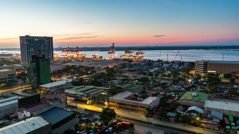 Cebu City, Philippines - June 7, 2018: Cebu City Timelapse view showing view over port of Cebu with ships loading