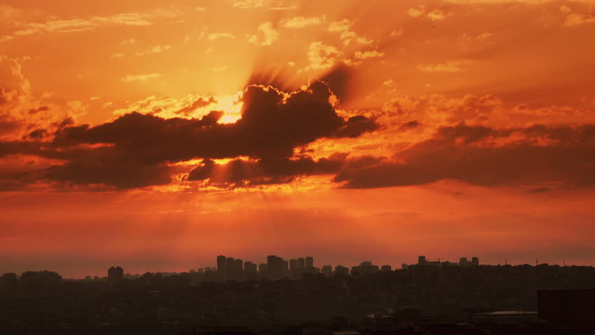 Time lapse sunset on the cloudy sky over city,  Turkey, Istanbul