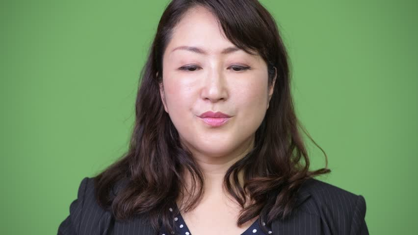 Mature beautiful Asian businesswoman covering mouth as three wise monkeys | Shutterstock HD Video #1013378930