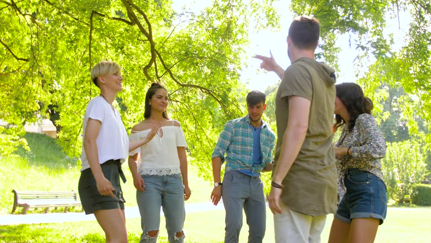 Leisure, fun and entertainment concept - happy friends dancing at summer party in park | Shutterstock HD Video #1013423690