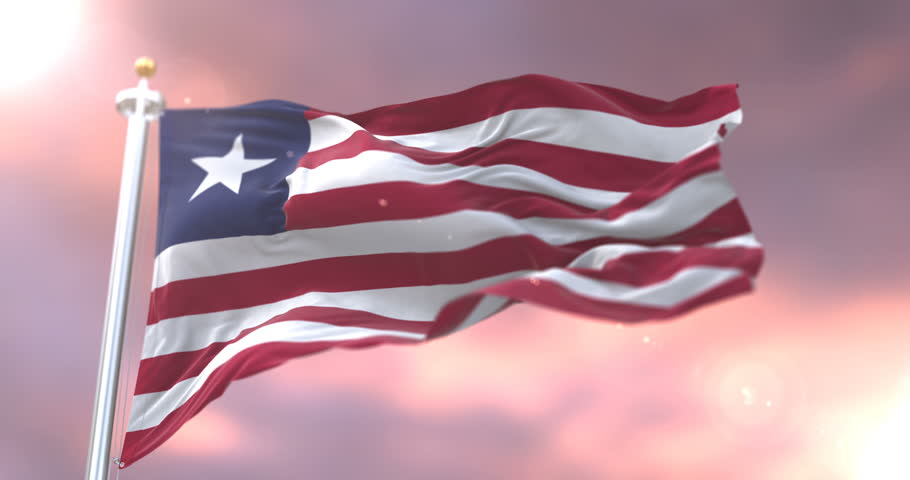 Flag of Liberia waving at wind at sunset in slow, loop