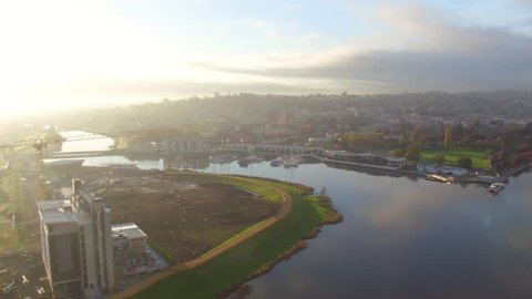 Aerial sunrise shot over the city of Launceston, Tasmania on a misty morning. Still water reflections looking at Peppers, Seaport, and Launceston CBD.