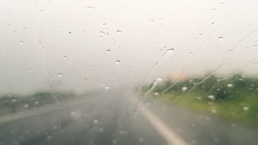 Footage of a car's wind screen, driving through the rain.  | Shutterstock HD Video #1013517530