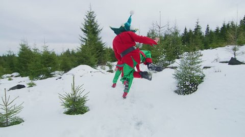 Famous Art - theatre company Romania / Christmas elves running and jumping in the forest.