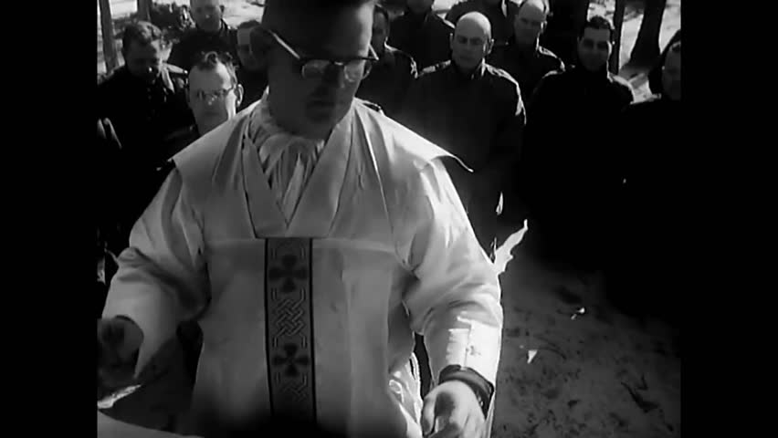 CIRCA 1962 - As part of their training, chaplains set up field altars and perform mock funerals. | Shutterstock HD Video #1013544380