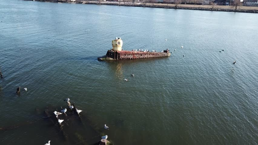Aerial drone footage video from Coney Island Creek with abandoned wooden ships. Brooklyn. New York