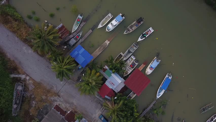 Fine art footage, Aerial view of Fisherman jetty at Kelanang beach, Malaysia during sunset. 4k | Shutterstock HD Video #1013591870