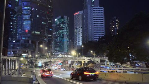 Street Traffic With Night Skyline Of Central Hong Kong In Background