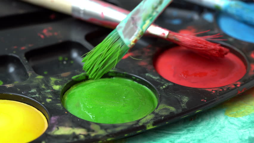 Brush taking green watercolor on color palette  | Shutterstock HD Video #1013598410