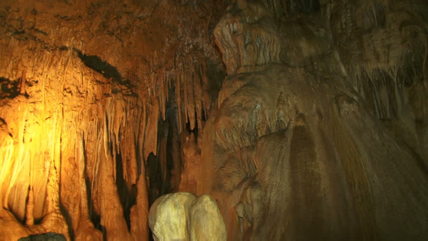 Great ancient caves. Inside, the deep and ancient caves. Moving camera.