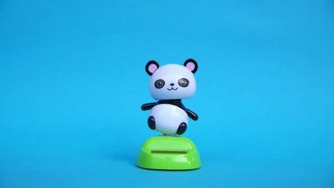 White panda doll dancing on green screen background.