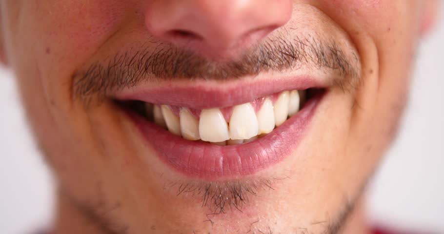 Happy young man concept smiling at camera confidence successful relaxed male white teeth healthy confident male attractive portrait close up happiness full plump lips perfect straight  | Shutterstock HD Video #1013640980