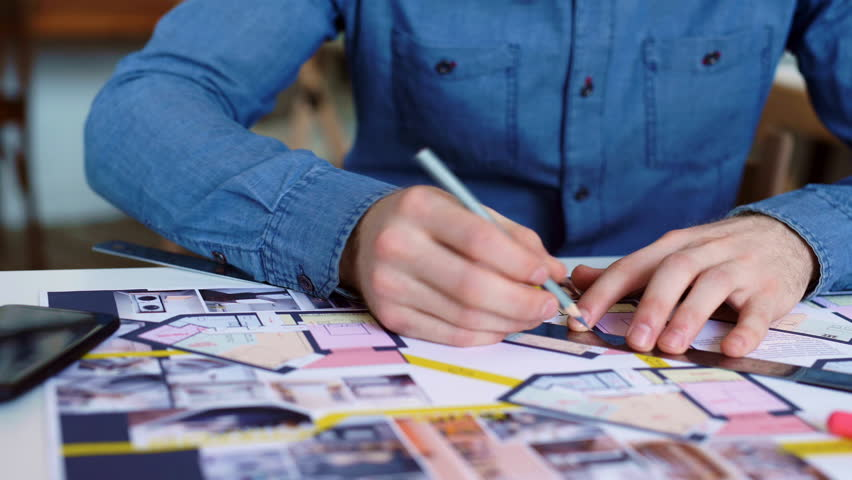 Architect working on blueprint with spesial tools and pencil, close up. Male architect at work, only hands with ruler and pencil. Design of the house. Engineer. Tools for drawing. Creating a drawing.   Shutterstock HD Video #1013643560