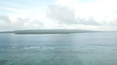 Aerial view of the peaceful scenery around a island in Wakatobi National Park in Indonesia. This region harbors high marine biodiversity and is a popular destination for scuba diving and snorkeling.
