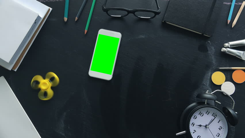 Back to school, top view flat lay concept with green screen smartphone and various educational accessories on blackboard | Shutterstock HD Video #1013720990