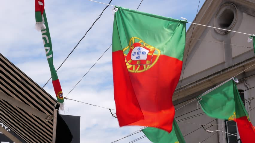 Portugal Flags Waving In Street. Many flags of Portugal waving and decorating the street in Lisbon