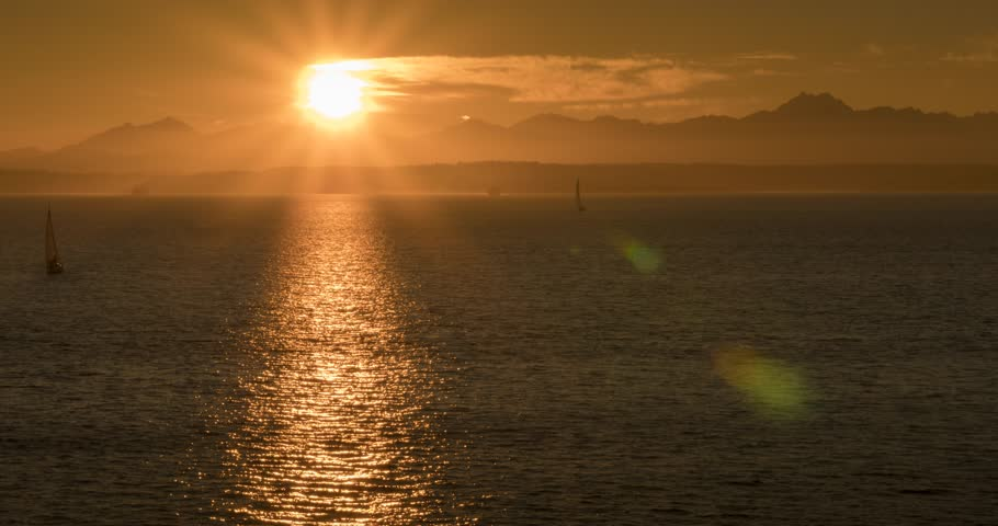 Time lapse of sunset over Bainbridge Island from Downtown Seattle, Seattle, Washington, USA, North America   Shutterstock HD Video #1013732510