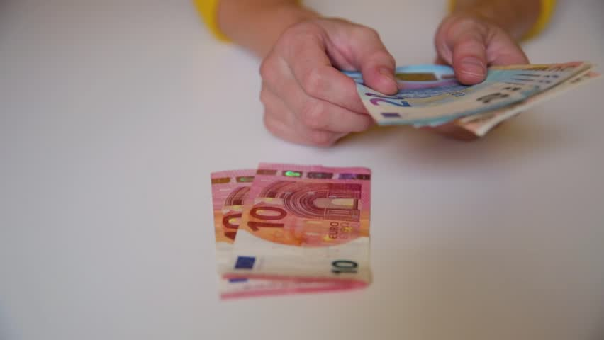 Woman's hands holding and counting European Euro bills. Wealth, cash, money concept   Shutterstock HD Video #1013732870