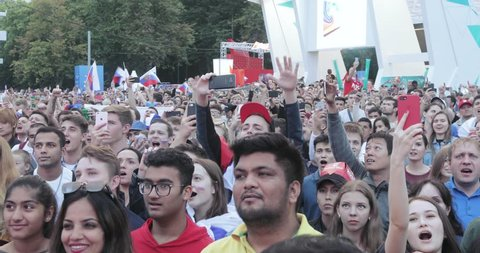 RUSSIA, MOSCOW - JULY 3, 2018: Hymn singing. Viewing football match Russia - Croatia football fans at FIFA Fan Fest Vorobyovy Gory in July 2018 in Moscow Russian Federation