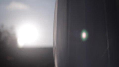 Warm sun light shining through sheer curtains