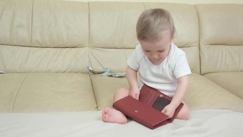 Little child finds money in the wallet   Shutterstock HD Video #1013777870