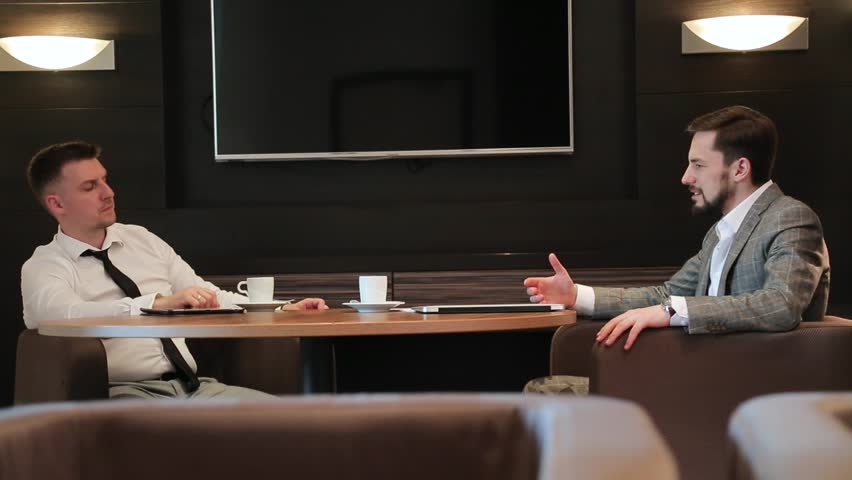Business meeting of two young men   Shutterstock HD Video #1013808440