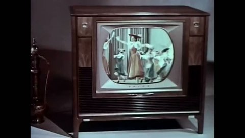CIRCA 1960s - The wonders of the newly invented remote control are displayed along with a model displaying a retro television set.