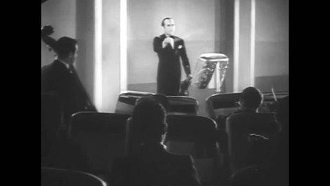 CIRCA 1933 - Dave Rubinoff and his orchestra play before a Betty Boop cartoon.