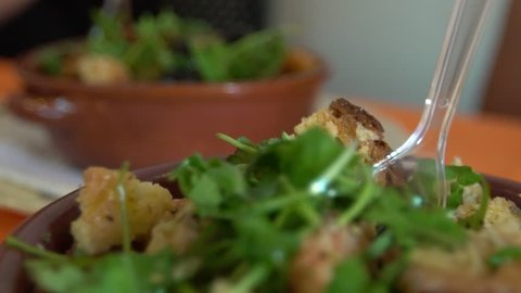 Slow Motion of Cialledda in a restaurant. Salad mixing stale bread with chopped up tomatoes from the Puglia and Basilicata in south of Italy. Culinary Italian cookery with different ingredients. -Dan