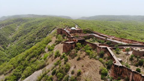 Aerial panoramic view of Jaigarh Fort (Fort of Victory) from red sandstone in historical city of Amer, great wall - near Jaipur, Rajasthan, landscape panorama of Northern India, Asia from above