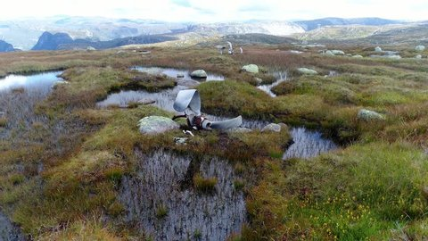 A UK WWII Bomber plane B-24 crashed on a mountain in southern Norway 1946, Fly over Propellers