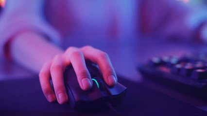 Close-up on the Hands of the Girl Gamer Playing in the Video Game Using Keyboard. Female Hacker Breaks into System. Background with Cool Neon Lights. Shot on RED EPIC-W 8K Helium Cinema Camera.