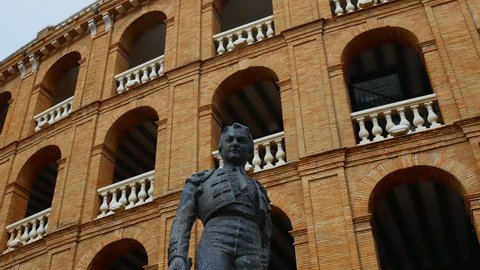 statue of a bullfighter in front of the bullfight arena in Valencia, Spain
