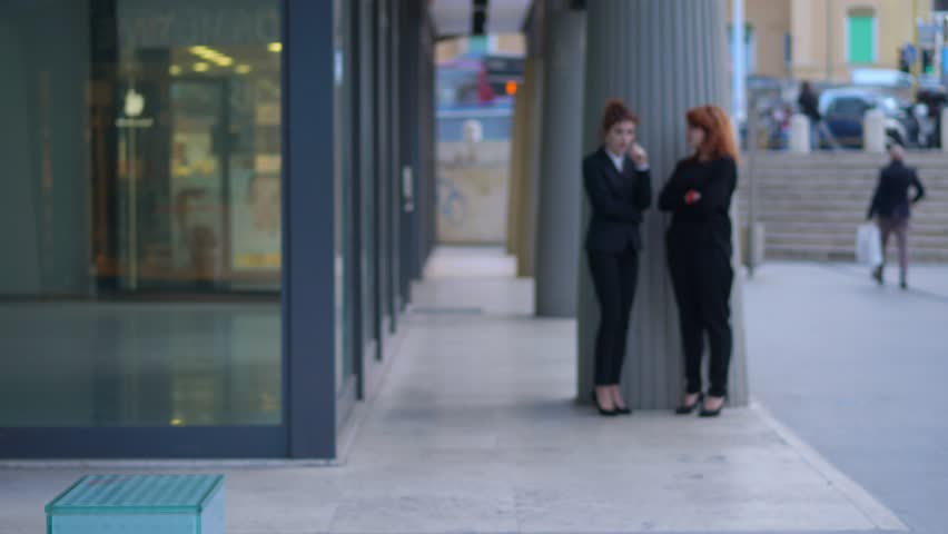 Two working business women communicate dismissal to their colleague | Shutterstock HD Video #1013916470