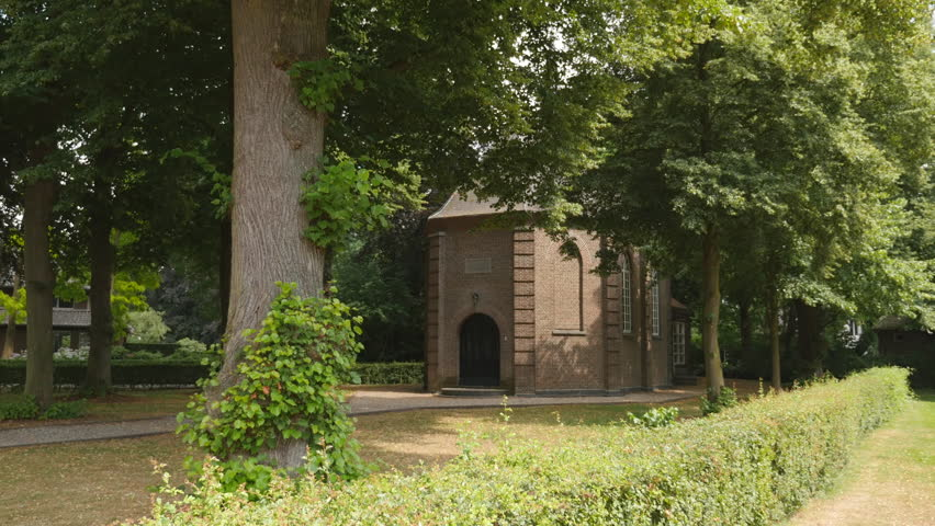 """Tilt up of the little Van Gogh church in Nuenen. Painting: """"Congregation Leaving the Reformed Church in Nuenen"""" which was stolen in 2002 and recovered in 2016."""
