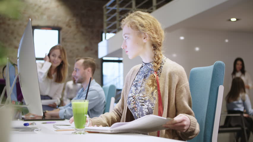 Young woman working in modern creative office | Shutterstock HD Video #1013949920