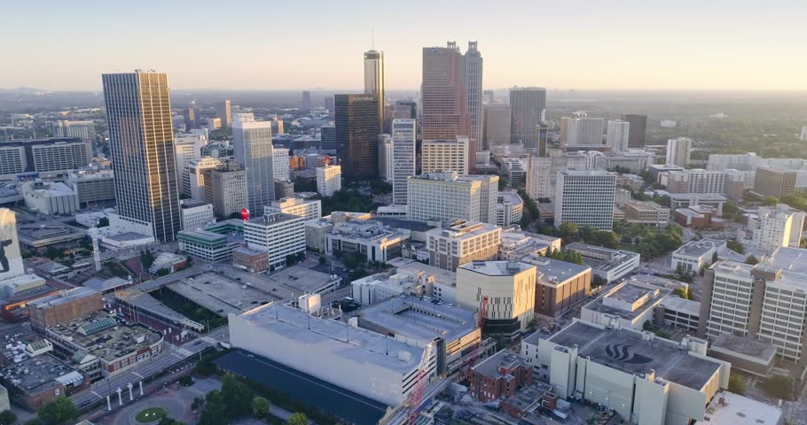 Aerial: Atlanta city skyline at sunrise