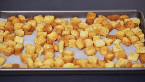 Fresh french toast croutons on baking sheet.