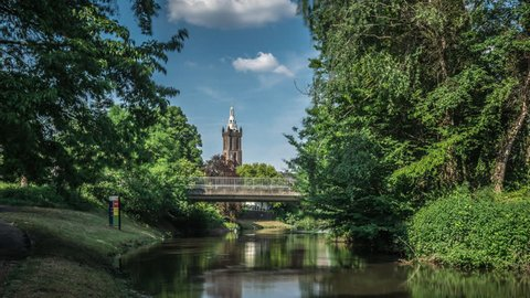 Bridge over the river Rur in the city of Roermond, Limburg, The Netherlands. Saint Christopher's cathedral in the background. Time lapse footage with some moving clouds.