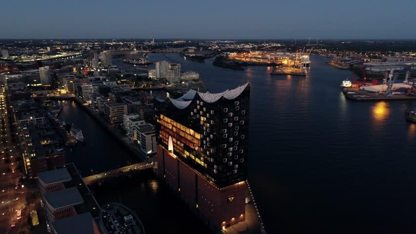 Aerial View of Elbphilharmonie and HafenCity at sunset, Hamburg, Hanseatic City. City lit up at night, Hamburg, Germany Night city landscape. Amazing architecture.