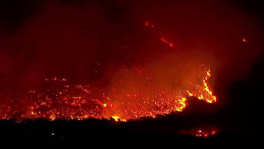 2017 - the Thomas Fire burns at night in the hills above the 101 freeway near Ventura and Santa Barbara, California.   Shutterstock HD Video #1014058220