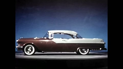 CIRCA 1950s - A Pontiac Styling automobile is shown in a showroom and it is driven on a rural road.