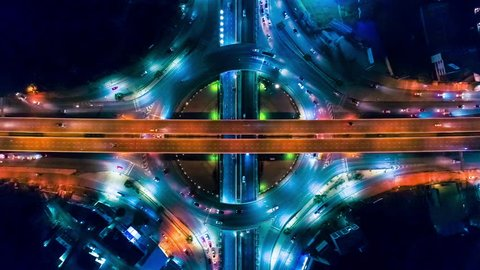 Aerial shoot top view circle road Traffic in city at night, 4K, time lapse, bangkok , thailand.