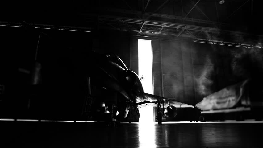 Fighter Jet in a Hangar. The Door is Closing. Black and White Tone.