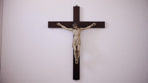 Crucified Jesus Christ. Religious sculpture of Jesus christ crucified in a cross, Hand held shot