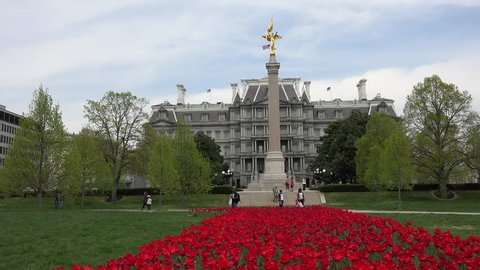 WASHINGTON, DC - APR 2015: Washington DC Eisenhower Executive Office Building garden flowers 4K. Built between 1871 and 1888. The First Division Monument commemorates those who died in U. S. Army.