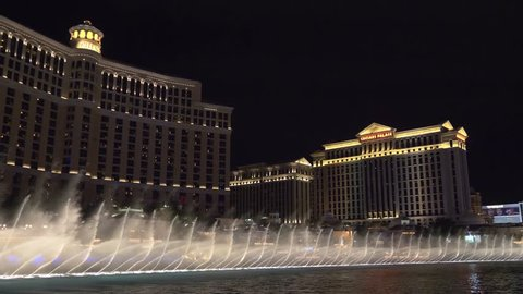 Las Vegas, Nevada - April 2018: Bellagio fountain water show at night in Las Vegas. Fountains at Bellagio Hotel and Casino in Las Vegas. Musical Show Fountains in Las Vegas. 4k video night shooting.