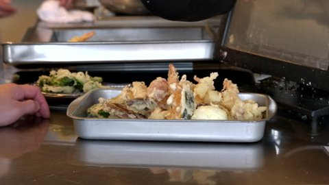 freshly cooked tempura prawns and vegetables in a tray at a kawaguchiko restaurant, japan
